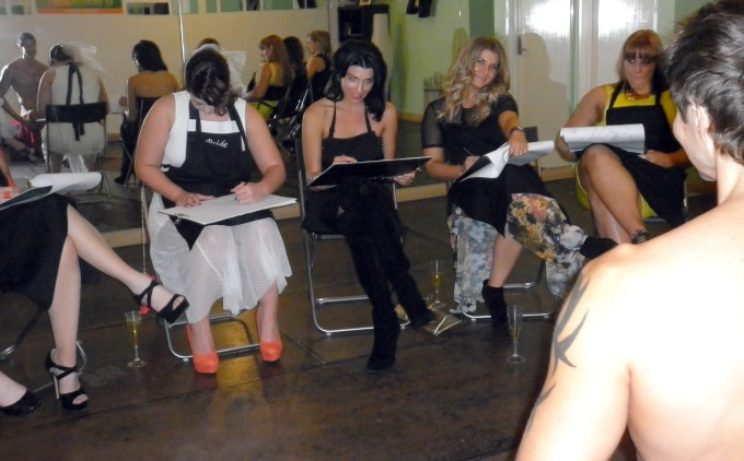 girls at a hens party drawing a life model